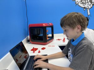 Boy typing on a laptop computer
